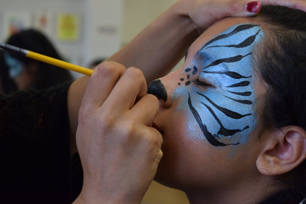 One of the young people having their face painted