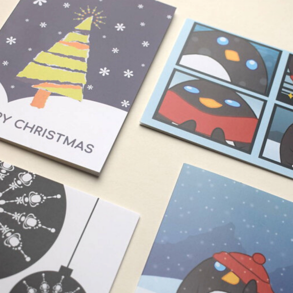 A selection of digitally created Christmas cards, featuring Christmas trees, penguins and baubles. All in a mixture of colours.